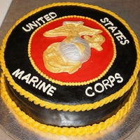 Marine Groom's Cake   Covered in fondant, emblem made with candy melts & colored with luster dust. Piping in icing