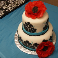 Black And White Damask With Red And Turquoise Accents MMF covered cake with damask stenciling. Flowers made from gumpaste.