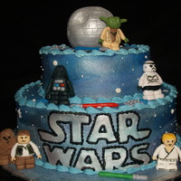 Star Wars Lego Theme Tiered cake- iced in buttercream. Logo in fondant. Characters hand molded from gumpaste.