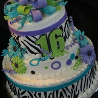Sweet 16 Zebra Print Buttercream cake with fondant zebra and other accents. Bow, flowers, and numbers made from gumpaste