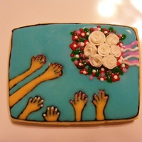 Catch! Large sugar cookie with icing glaze & fondant roses.