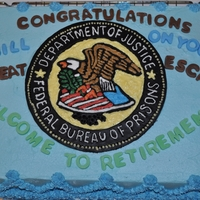Retirement BC icing,Marble Cake, Emblem made from fondant carved out,filled with BC icing