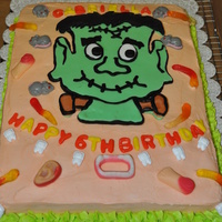 Young Frankenstien Speckled white cake,BC Icing,Fondant Frankie and lettering,gummies