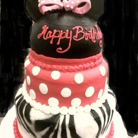 Minnie iced buttercream, gumpaste ears and bow