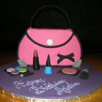 My First Purse Cake! Following the yummyarts how-to video. Turned out pretty good. TFL