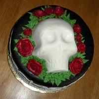 Death By Chocolate Auction cake for a Great American Bake Sale at a Trunk or Treat event.Candy clay skull, chocolate cake, chocolate fudge filling, chocolate...