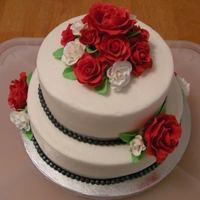 Sweet And Simple Sweet and simple for a small wedding.Gumpaste roses, fondant beading and buttercream all around.