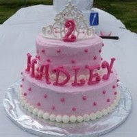 Pink Princess My daughters 2nd birthday, two tier pink princess cake. With royal icing tiera and name.
