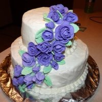 Purples Roses Class cake, two tier with purple fondont roses.