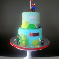 Super Mario Themed Birthday Cake A 4th Birthday cake for my son who wanted a Super Mario theme. Both cakes were almond cakes, with blackberry filling, and white chocolate...