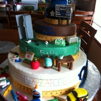 Story Book Graduation Cake  I made this graduation cake for my brother to tell a story of his life. It starts with kindergarten and works up to grade 12. He plays many...