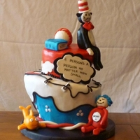 Dr Seuss Baby Shower Cake!   This is a carrot cake and creme cheese topst turvy cake! its covered in MMF and the characters are made from gumpaste!