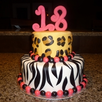 18Th Birthday Cake!  This is a red velvet cake filled with cream cheese icing tht i made for my friends 18th birthday! the 18 on top is made out of gumpaste and...
