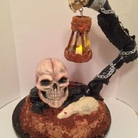 This Cake Was Made With All Edible Materials Chocolate Lantern Cake Base Modeling Chocolate Arm Cereal Treat Skulland Truffle Rat Supe  This cake was made with all edible materials. Chocolate lantern, cake base, modeling chocolate arm, cereal treat skull,and truffle rat....