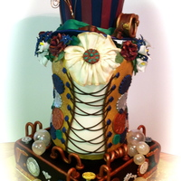 Whimsical Steam Punk Wedding Cake Whimsical, vintage, steam punk themed wedding cake brings not only the elements of steam punk, but adds a splash of peacock colors to its...