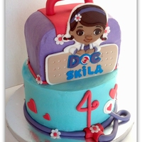 Doc Mcstuffins All white cake with vanilla buttercream. All decor is marshmallow fondant