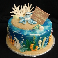 Sea Baby This is a small buttercream cake for a 2nd birthday. The octopus is gumpaste and the dimensional coral is royal icing. All coral on the...