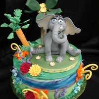 Horton Hears A Who A fantasy jungle cake with a keepsake gumpaste Horton the Elephant figure. Most of the flowers and plants are gumpaste or royal icing.