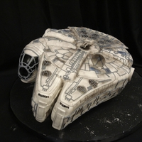 Star Wars Millenium Falcon This cake was a challenge! It is difficult to see in the photo, but the entire cake is raised on 4 dowels and canted at an angle about 2...