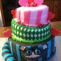 "Alice In Wonderland Cheshire Cat 6"", 8"", and 10"" topsy French vanilla cake with vanilla buttercream filling; fondant covered; all decorations are fondant...."