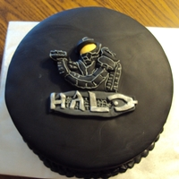 "Halo Cake 10"" inch 3 layer Marble cake with vanilla buttercream filling; fondant covered with fondant logo and master chief. Thanks for looking..."