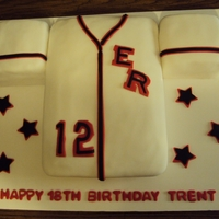 Baseball Jersey Baseball jersey cake is a 9 x 13 Double Chocolate Fudge with Vanilla buttercream filling; fondant designs. Thanks for looking!