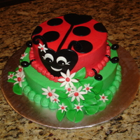 Ladybug Buttercream with fondant accessories.