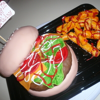 Burger And Fries   marble cake covered in fondant with fondant garnishes, RI condiments, RK pattie and fries. very fun to make!!