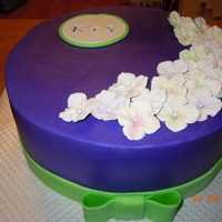 "Simple Purple Shower Cake With Monogram This is a 10"" round white / choc marble cake with milk chocolate truffle filling. It's frosted in indydebi's buttercream..."