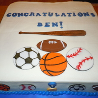 Sports Graduation Cake 12x12 square cake - 1/2 white, 1/2 chocolate with white chocolate truffle filling. Buttercream frosting and fondant decorations.
