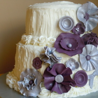 "Purple And Silver Fantasy Flowers 6""/9"" round smores cake with rustic buttercream frosting and fondant flowers."