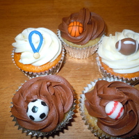 Sports Cupcakes  Orange dreamsicle cupcakes with IMBC and Smores cupcakes - graham cracker cupcake, marshmallow filling, chocolate buttercream. Each topped...
