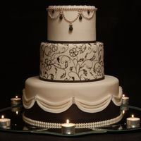 Romance In Black Fondant covered cake with fondant details and freehand piping on the middle tier. TFL!