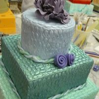 205.jpg This was my first attempt with fondant, square cakes and rolled roses!