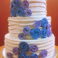 Wedding  Red Velvet cake w/vanilla buttercream. The photo doesnt do it justice at all, the ribbon roses are violet and periwinkle blue - I need a...
