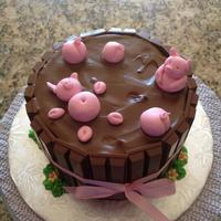"Pigs In Mud *6"" cake with chocolate buttercream and kit kat candy bars. Fondant pigs."