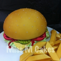Cheeseburger & Fries Fondant covered ganached mud cake.