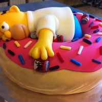 Homer & His Donut Inspired from other users of Cake Central. Fondant covered cake. Homer sculpted from fondant as are beer cans.