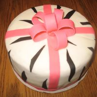 Zebra Cake covered in MMF, fondant accents and bow