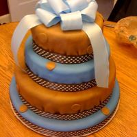 "Baby Boy Classic chocolate fondant covered. I tried to make the fondant layers look ""tucked in"" to match his bed linens"