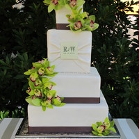 "Rochelle's Wedding Cake Wedding cake we just finished. 4, 6, 9, and 12"" tiers. Fondant covered with edible image monogram, edible pearls, real ribbon and..."
