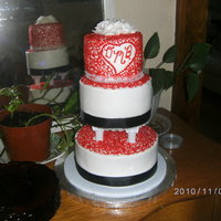 Son's Very Quicky Wedding Cake All Buttercream with royal icing roses and fabric ribbon.