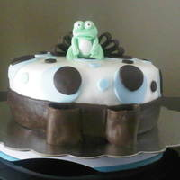 Frog Baby Shower Cake I made this for a friend. Covered in fondant with fondant circles. The frog is a mix of gum paste and fondant. The bow is made from...