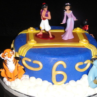 Princess Jasmine This cake was for a friends daughter who loves Princess Jasmine from Alladin. WASC covered with fondant and also fondant accents brushed...