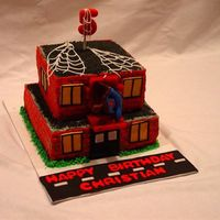 Spiderman   Fondant bricks on buttercream. Spiderman is a candle