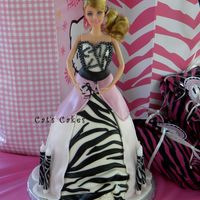 Jilly's Barbie Party Birthday Cake Zebra striped marble cake filled with chocolate brownie buttercream and vanilla buttercream and covered in MMF and candy pearls.
