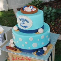 Baseball Themed Baby Shower Cake   Baby blue Yankees baby shower cake with marshmallow fondant baseballs, hat, and ball.