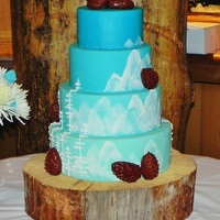 Aqua Mountain Cake With Pinecones All marshmallow fondant with buttercream mountains and trees. The pinecones were all marshmallow fondant. Original design by Intricate...
