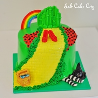 Wizard Of Oz Cake  All marshmallow fondant details here including the Emerald City, Ruby red Slippers, wicker basket, witch legs and hat :) Loved making this...