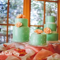 Mint & Coral Trio Wedding Cake   I loved making this trio of mint wedding cakes with coral sugar flowers on each cake.